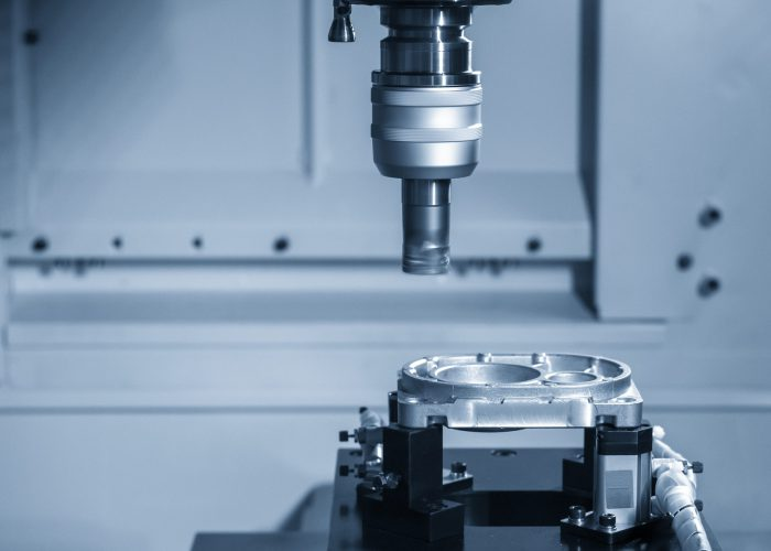 The CNC milling machine rough cutting  the aluminum casting  parts by indexable  endmill tools. The automotive parts manufacturing process by machining center.